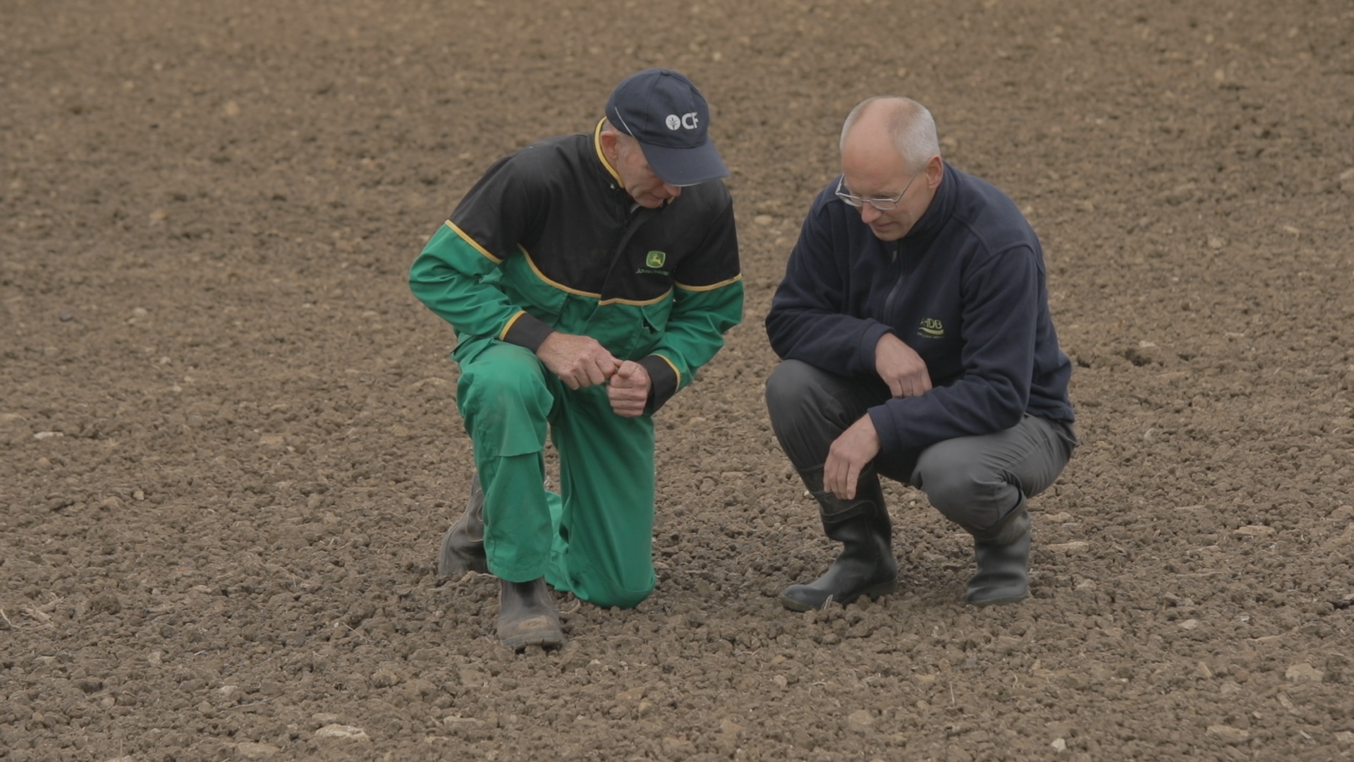Roger Wilson (left) and Philip Dolbear (right) look at soil