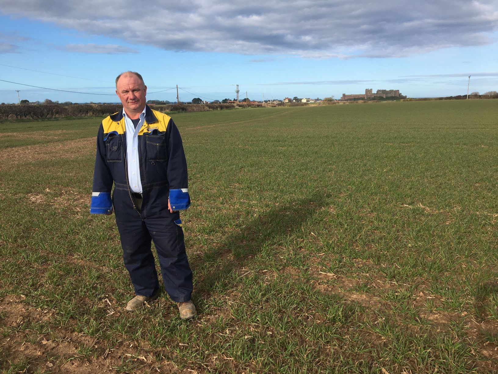Chathill Monitor Farmer Pip Robson standing in field